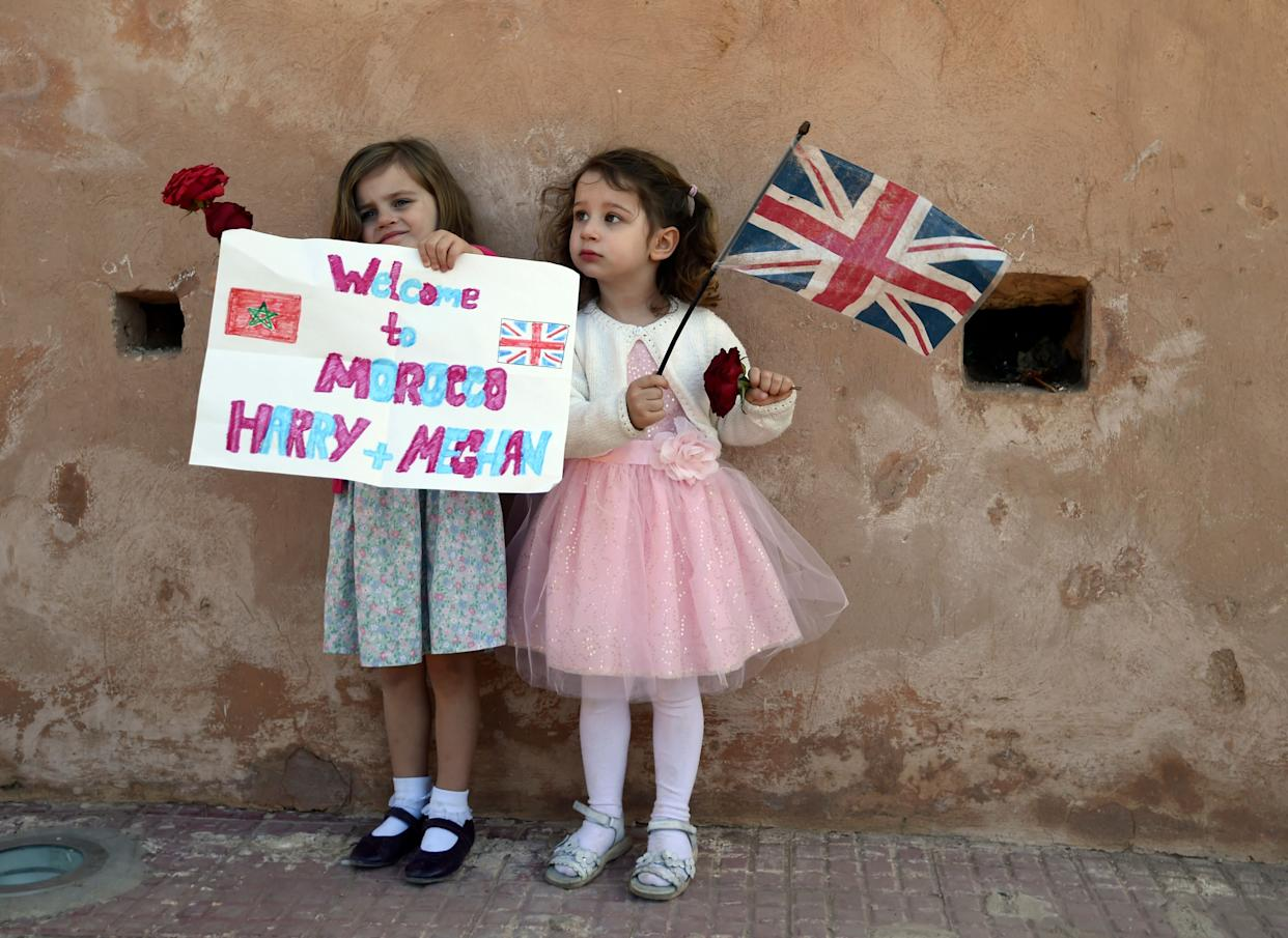 Children wait for the arrival of Britain's Prince Harry and Meghan, Duchess of Sussex at the Andalusian Gardens in Rabat, Morocco, Monday, February 25, 2019.