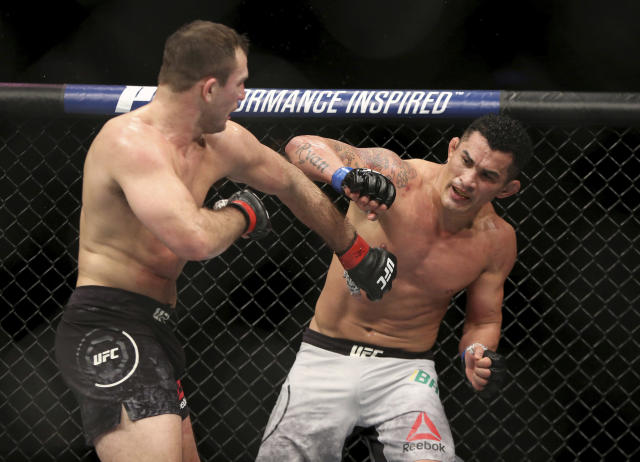 Gian Villante, left, and Francimar Barroso exchange blows during a mixed martial arts bout at UFC 220, Saturday, Jan. 20, 2018, in Boston. Villante won via decision. (AP Photo/Gregory Payan)