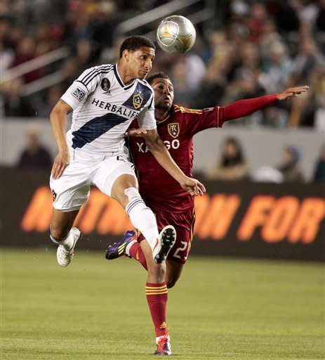 Los Angeles Galaxy defender Sean Franklin, left, and Real Salt Lake forward Paulo Junior battle for the ball during the first half of an MLS soccer match, Saturday, March 10, 2012, in Carson, Calif. (AP Photo/Bret Hartman)