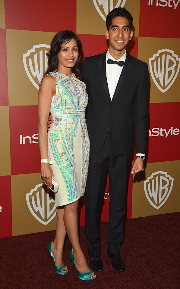 Freida Pinto and Dev Patel attend the 2013 InStyle and Warner Bros. 70th Annual Golden Globe Awards Post-Party held at the Oasis Courtyard in The Beverly Hilton Hotel on January 13, 2013 in Beverly Hills, California.