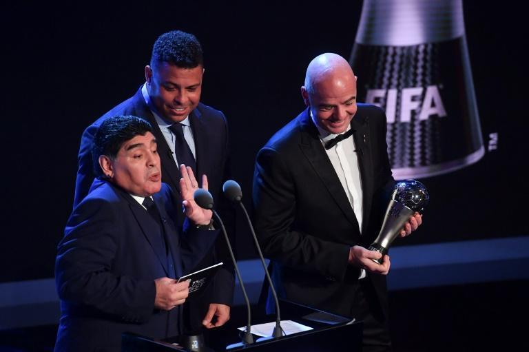 Former Brazil striker Ronaldo (centre) and FIFA president Gianni Infantino (right) paid their respects to Diego Maradona (left)