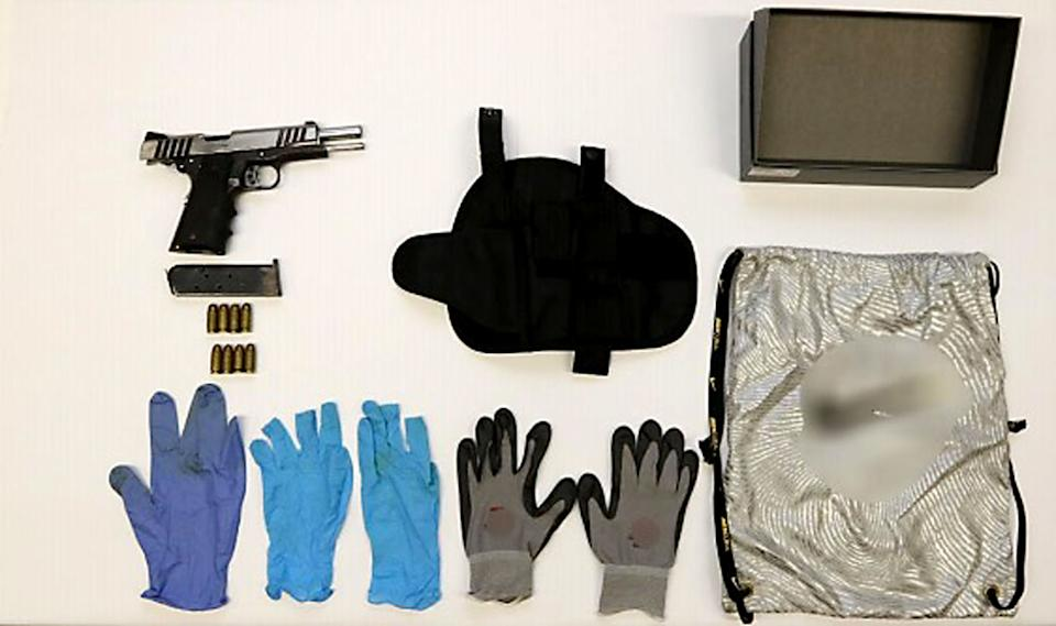The pistol, eight rounds of ammunition and other times seized during the joint SPF and CNB operation. (PHOTO: SPF)
