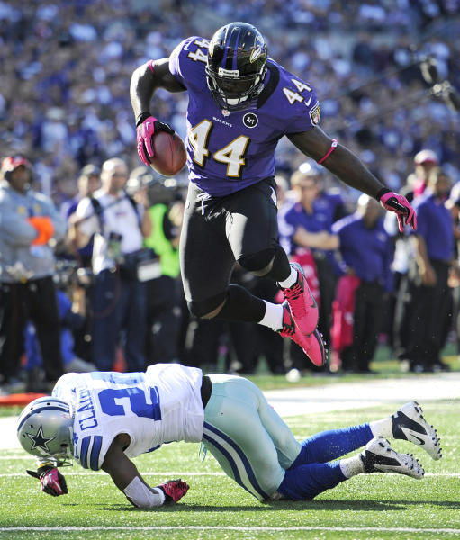 Baltimore Ravens fullback Vonta Leach, top, leaps over Dallas Cowboys cornerback Morris Claiborne in the second half of an NFL football game in Baltimore, Sunday, Oct. 14, 2012. Baltimore won 31-29. (AP Photo/Nick Wass)
