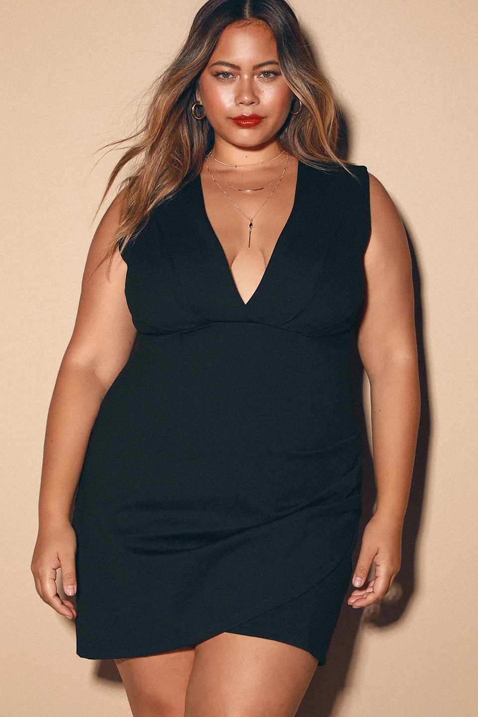 """<h2>Lulus Cocktail Hour Black Wrap Dress </h2><br><strong><h3>Best Plus-Size Cocktail Hour Dress</h3></strong><br><strong>Sizes Available: XXS-3X</strong><br>This dress is made in a faux-wrap design, which gives you all the style benefits of a wrap silhouette without the overcomplication of making sure it's securely tied.<br><br>""""Love this dress! The material is thick and stretchy. Holds everything in without showing the lumps & bumps. 10 /10."""" <em>– Sara W., Size 1X</em><br><br><em>Shop <strong><a href=""""https://www.lulus.com/products/cocktail-hour-black-wrap-dress/293322.html"""" rel=""""nofollow noopener"""" target=""""_blank"""" data-ylk=""""slk:Lulus"""" class=""""link rapid-noclick-resp"""">Lulus</a></strong></em><br><br><strong>Lulus</strong> Cocktail Hour Black Wrap Dress, $, available at <a href=""""https://go.skimresources.com/?id=30283X879131&url=https%3A%2F%2Fwww.lulus.com%2Fproducts%2Fcocktail-hour-black-wrap-dress%2F293322.html"""" rel=""""nofollow noopener"""" target=""""_blank"""" data-ylk=""""slk:Lulus"""" class=""""link rapid-noclick-resp"""">Lulus</a>"""