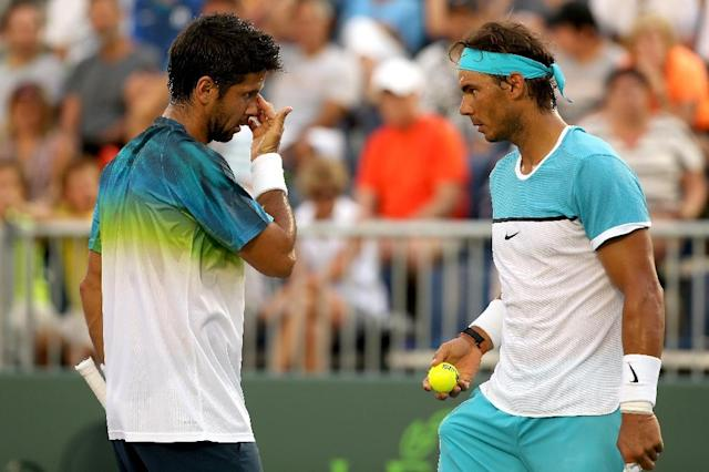 Fernando Verdasco and Rafael Nadal of Spain confer between points while playing Simone Bolelli and Andreas Seppi of Italy during the Miami Open on March 24, 2016 in Key Biscayne, Florida (AFP Photo/Matthew Stockman)