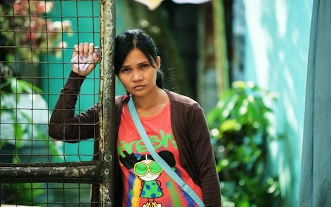 Jasmine, a mother of three children, could not afford to bury her husband when he fell victim to the Philippines drugs war - Credit: Eugene Ibis