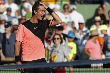 Mar 24, 2018; Key Biscayne, FL, USA; Thanasi Kokkinakis of Australia reacts after his match against Roger Federer of Switzerland (not pictured) on day five of the Miami Open at Tennis Center at Crandon Park. Kokkinakis won 3-6, 6-3, 7-6(4). Mandatory Credit: Geoff Burke-USA TODAY Sports