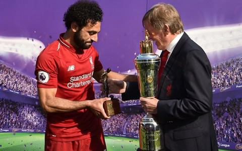 Salah receives his Player of the Year award from Kenny Dalglish - Credit: Getty Images