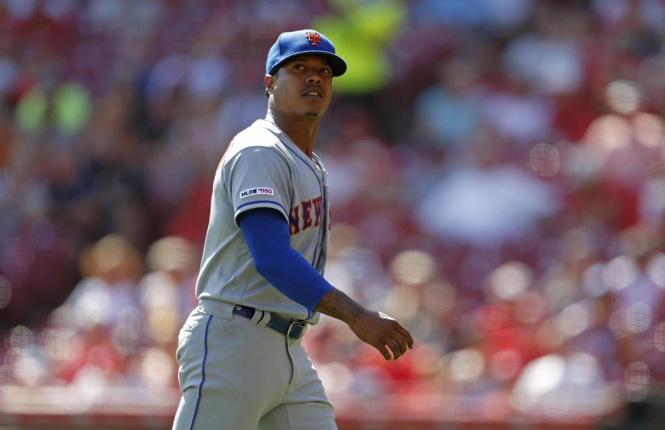 New York Mets starting pitcher Marcus Stroman reacts as he is pulled during the fifth inning of a baseball game, against the Cincinnati Reds Sunday, Sept. 22, 2019, in Cincinnati. (AP Photo/Gary Landers)