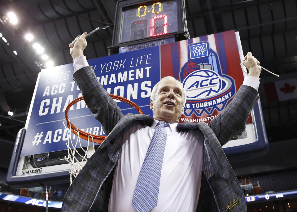 FILE - North Carolina head coach Roy Williams holds part of the net after an NCAA college basketball game in the championship of the Atlantic Coast Conference tournament against Virginia in Washington, in this Saturday, March 12, 2016, file photo. North Carolina announced Thursday, April 1, 2021, that Hall of Fame basketball coach Roy Williams is retiring after a 33-year career that includes three national championships. (AP Photo/Alex Brandon, File)