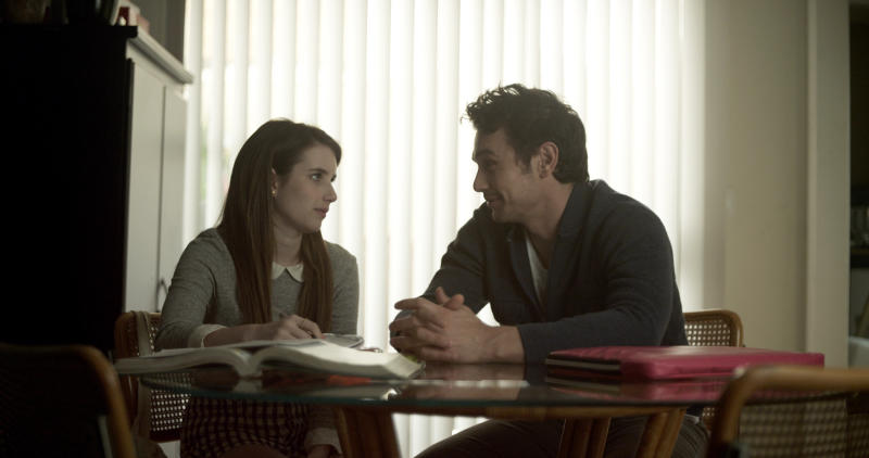 "This photo released by Tribeca Films shows Emma Roberts, left, and James Franco in a scene from the film, ""Palo Alto."" (AP Photo/Tribeca Films)"