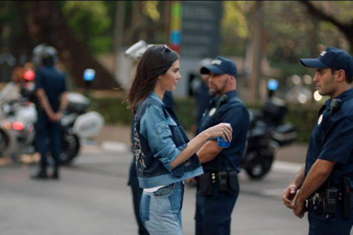Kendall Jenner makes the peace in the pulled Pepsi advert (Picture: Pepsi)