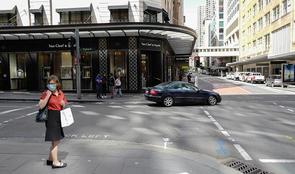 People moving around the Sydney CBD district on a Wednesday morning during the Covid-19 pandemic on in Sydney, Australia.