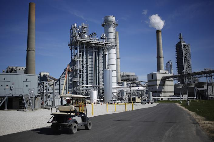 An employee drives past equipment installed as part of the Petra Nova Carbon Capture Project at the NRG Energy Inc. WA Parish generating station in Thompsons, Texas.