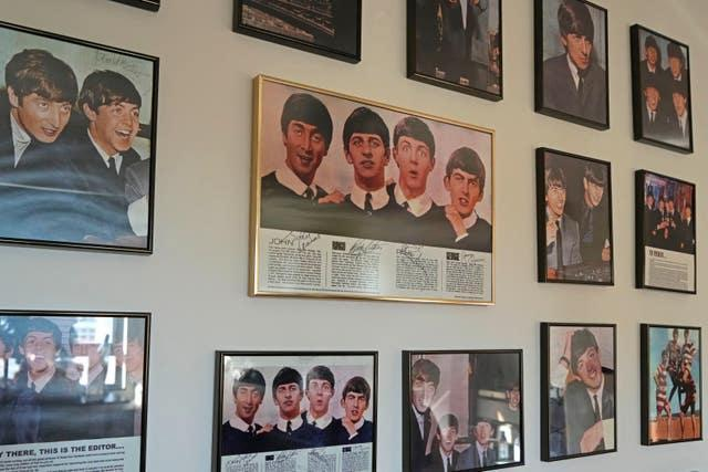 Copies of Ray's Beatles autographs are framed and displayed at his home