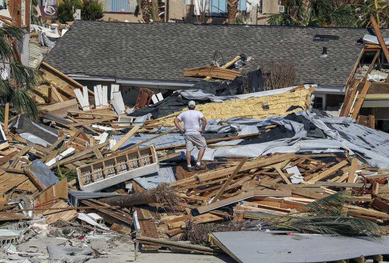 Jay Faulk, 56, surveys the damage to his home, Friday, Oct. 12, 2018 in Mexico Beach, Fla. Residents of the small beach town of Mexico Beach began to make their way back to their homes some for the first time after Hurricane Michael made landfall Wednesday. (Chris Urso/Tampa Bay Times via AP)
