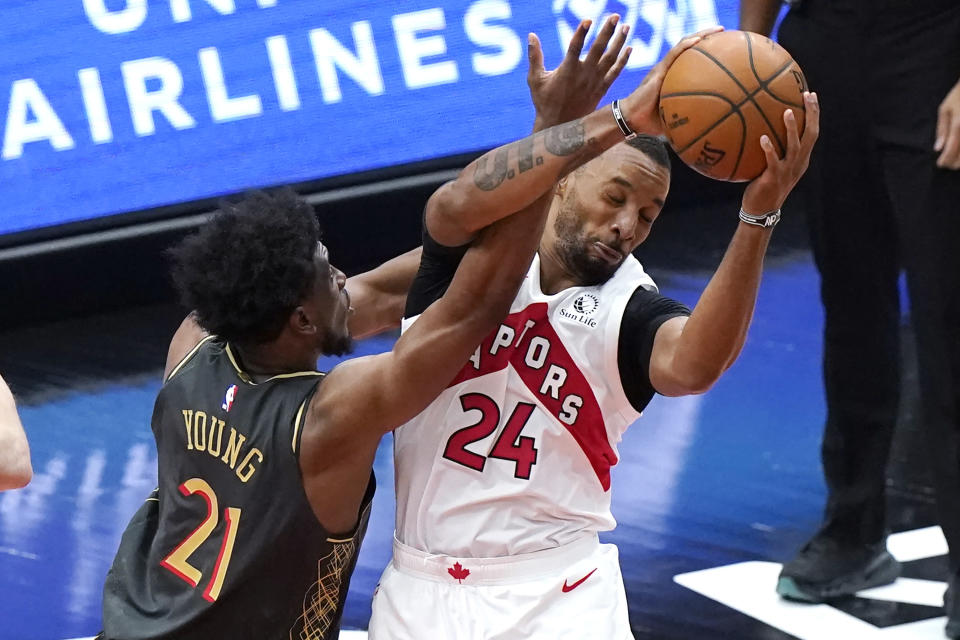 Toronto Raptors guard Norman Powell, right, rebounds the ball against Chicago Bulls forward Thaddeus Young during the second half of an NBA basketball game in Chicago, Sunday, March 14, 2021. (AP Photo/Nam Y. Huh)