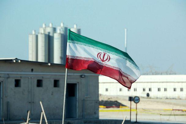 PHOTO: An Iranian flag flies at Iran's Bushehr nuclear power plant, during an official ceremony to kick-start works on a second reactor at the facility, Nov. 10, 2019. (Atta Kenare/AFP via Getty Images, FILE)