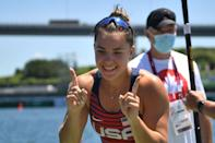 <p>Gold medallist USA's Nevin Harrison celebrates after winning the women's canoe single 200m final during the Tokyo 2020 Olympic Games at Sea Forest Waterway in Tokyo on August 5, 2021. (Photo by Philip FONG / AFP)</p>