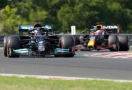 Mercedes driver Lewis Hamilton of Britain steers his car followed by Red Bull driver Max Verstappen of the Netherlands during the qualifying session for the Hungarian Formula One Grand Prix at the Hungaroring racetrack in Mogyorod, Hungary, Saturday, July 31, 2021. The Hungarian Formula One Grand Prix will be held on Sunday. (AP Photo/Darko Bandic)