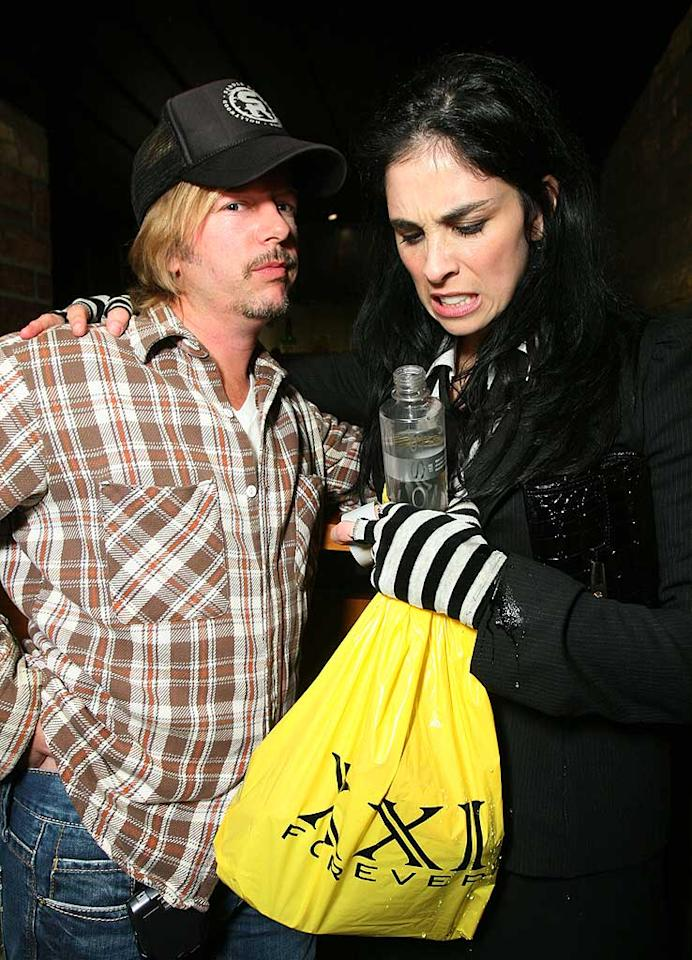 """David Spade pops a glamorous pose in his trucker hat, while Sarah grimaces as she rifles through her gift bag. Alexandra Wyman/<a href=""""http://www.wireimage.com"""" target=""""new"""">WireImage.com</a> - April 3, 2008"""