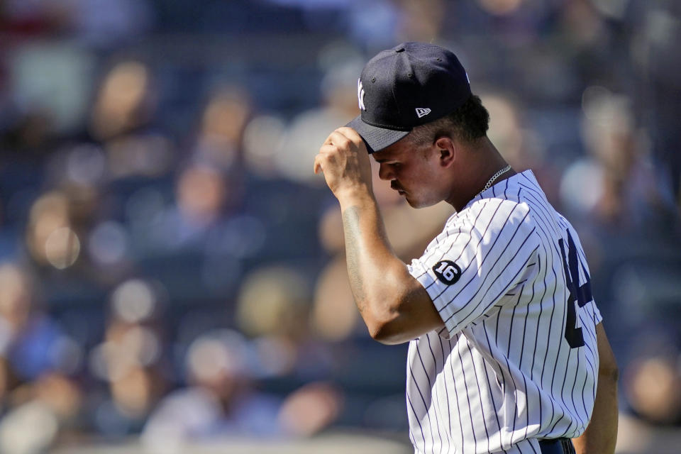 New York Yankees relief pitcher Albert Abreu walks back to the dugout after the close of the fifth inning of a baseball game against the Cleveland Indians, Saturday, Sept. 18, 2021, in New York. (AP Photo/John Minchillo)