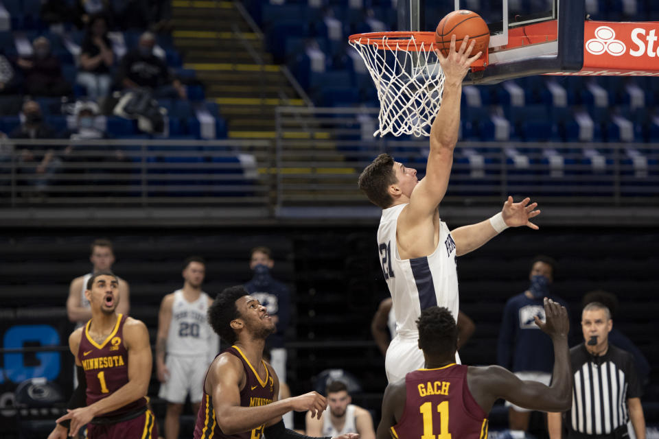 Penn State forward John Harrar (21) lays up the ball during the team's NCAA college basketball game against Minnesota on Wednesday, March 3, 2021, in State College, Pa. (Noah Riffe/Centre Daily Times via AP)