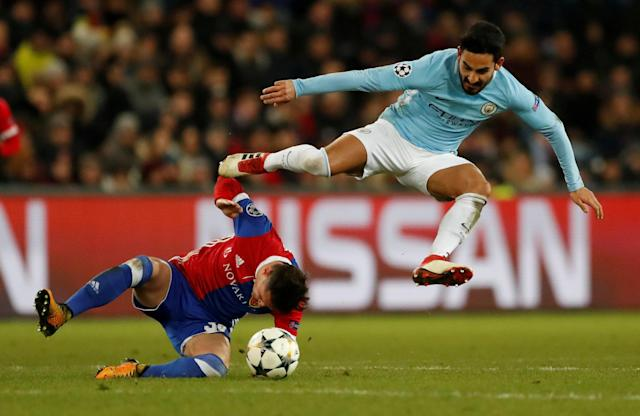 Soccer Football - Champions League - Basel vs Manchester City - St. Jakob-Park, Basel, Switzerland - February 13, 2018 Manchester City's Ilkay Gundogan in action with Basel's Taulant Xhaka Action Images via Reuters/Andrew Boyers TPX IMAGES OF THE DAY