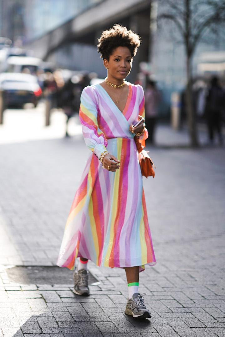 <p>One guest embraced the capital's sun in a rainbow-hued dress with neon socks and chunky trainers. <em>[Photo: Getty]</em> </p>