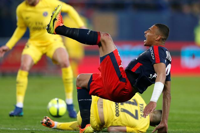 Soccer Football - Ligue 1 - Caen vs Paris St Germain - Stade Michel d'Ornano, Caen, France - May 19, 2018 Caen's Alexander Djiku goes down under the challenge of Paris Saint-Germain's Yuri Berchiche REUTERS/Pascal Rossignol