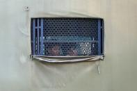 Myanmar migrants to be deported from Malaysia are seen inside an immigration truck, in Lumut