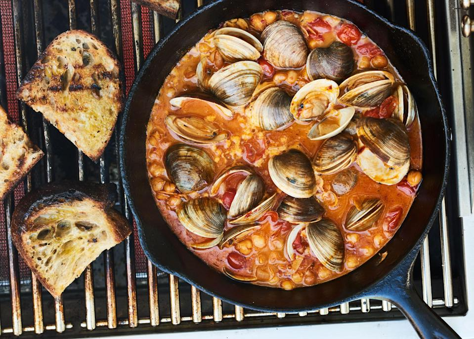 "Sure you can cook clams right on the grill grate, but getting a skillet involved means capturing all of their delicious briny juices. <a href=""https://www.bonappetit.com/recipe/chile-lime-clams-with-tomatoes-and-grilled-bread?mbid=synd_yahoo_rss"" rel=""nofollow noopener"" target=""_blank"" data-ylk=""slk:See recipe."" class=""link rapid-noclick-resp"">See recipe.</a>"