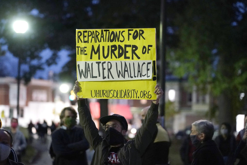 Protesters gather for a march Tuesday Oct. 27, 2020, in Philadelphia. Hundreds of demonstrators marched in West Philadelphia over the death of Walter Wallace, a Black man who was killed by police in Philadelphia on Monday. Police shot and killed the 27-year-old on a Philadelphia street after yelling at him to drop his knife. (AP Photo/Matt Slocum)
