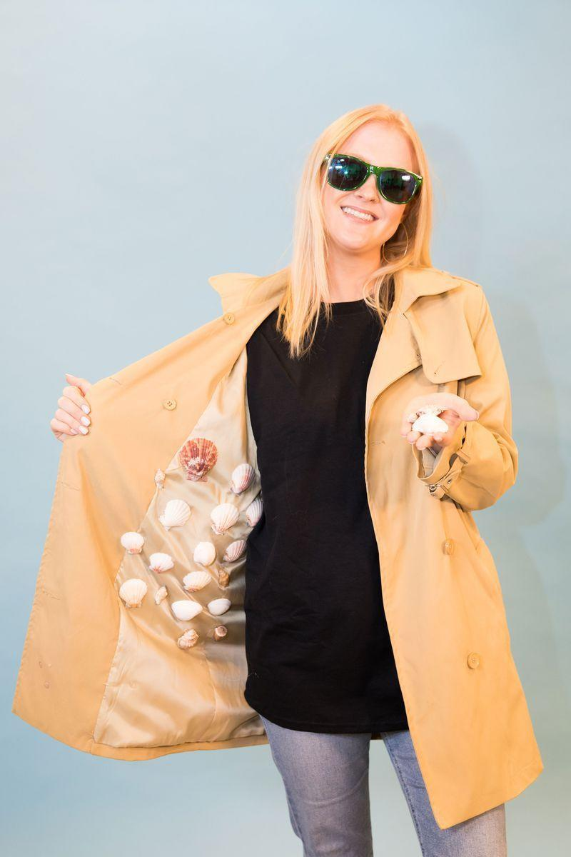 "<p>You can bring the ocean to the costume party when you show up in this coat, complete with all of your wares. Then, ask your friends to try and say ""she sells seashells"" five times fast. </p><p><strong><a class=""link rapid-noclick-resp"" href=""https://www.amazon.com/Wantdo-Womens-Double-Breasted-Trench-Coat/dp/B018AVXIBI/ref=cts_ap_1_vtp?tag=syn-yahoo-20&ascsubtag=%5Bartid%7C10055.g.3848%5Bsrc%7Cyahoo-us"" rel=""nofollow noopener"" target=""_blank"" data-ylk=""slk:SHOP TRENCH COATS"">SHOP TRENCH COATS</a></strong></p>"