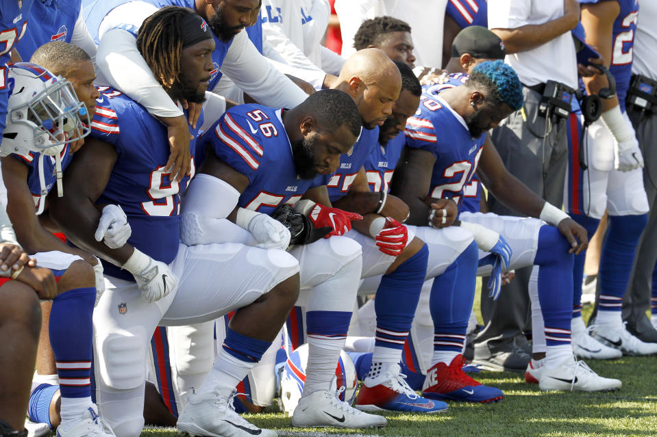 Buffalo Bills players kneel during the national anthem prior to their game against the Denver Broncos on Sunday. (AP)