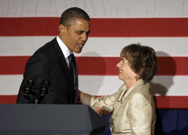President Barack Obama, left, is introduced by Rep. Jan Schakowsky, D-Ill., right, during a fundraiser in Chicago, Wednesday, May29, 2013. Obama traveled to Chicago for two fundraisers to raise money for the Democratic Congressional Campaign Committee. (AP Photo/Pablo Martinez Monsivais)