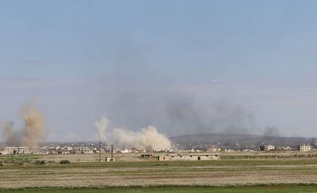 Smoke rises around the Syrian southern town of Bosra al-Sham
