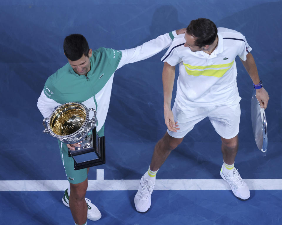 Serbia's Novak Djokovic, left, and Russia's Daniil Medvedev talk after receiving their trophies after Djokovic won the men's singles final at the Australian Open tennis championship in Melbourne, Australia, Sunday, Feb. 21, 2021. (AP Photo/Hamish Blair)