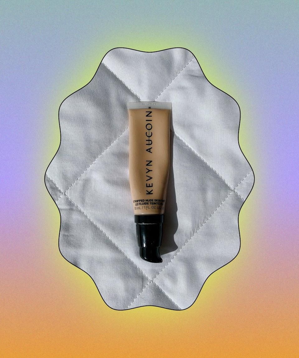 """I couldn't love this foundation any more than I do. It's featherlight but somehow blankets hyperpigmentation, redness and spots in a way that looks natural and radiant. It's one of the very few foundations which don't break me out and it stays put for hours without obviously collecting in dry patches or creases. While I'm no longer getting any product out of the pump, I've got to cut open the tube to make the most of what's left.<br><br><strong>Kevyn Aucoin</strong> Stripped Nude Skin Tint, $, available at <a href=""""https://www.beautybay.com/p/kevyn-aucoin/stripped-nude-skin-tint/medium-st-06/"""" rel=""""nofollow noopener"""" target=""""_blank"""" data-ylk=""""slk:Beauty Bay"""" class=""""link rapid-noclick-resp"""">Beauty Bay</a>"""