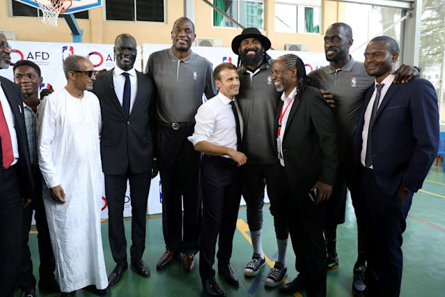 French President Emmanuel Macron and managing director of NBA Africa Amadou Gallo Fall (4thL) pose for a picture with former pro NBA Africa basketball players at the French Louis Pasteur high school in Lagos, Nigeria, July 4, 2018. Ludovic Marin/Pool via Reuters