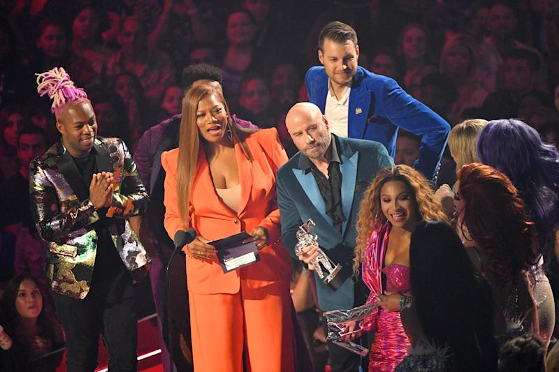 NEWARK, NEW JERSEY - AUGUST 26: Queen Latifah and John Travolta speak onstage during the 2019 MTV Video Music Awards at Prudential Center on August 26, 2019 in Newark, New Jersey. (Photo by Mike Coppola/Getty Images for MTV)