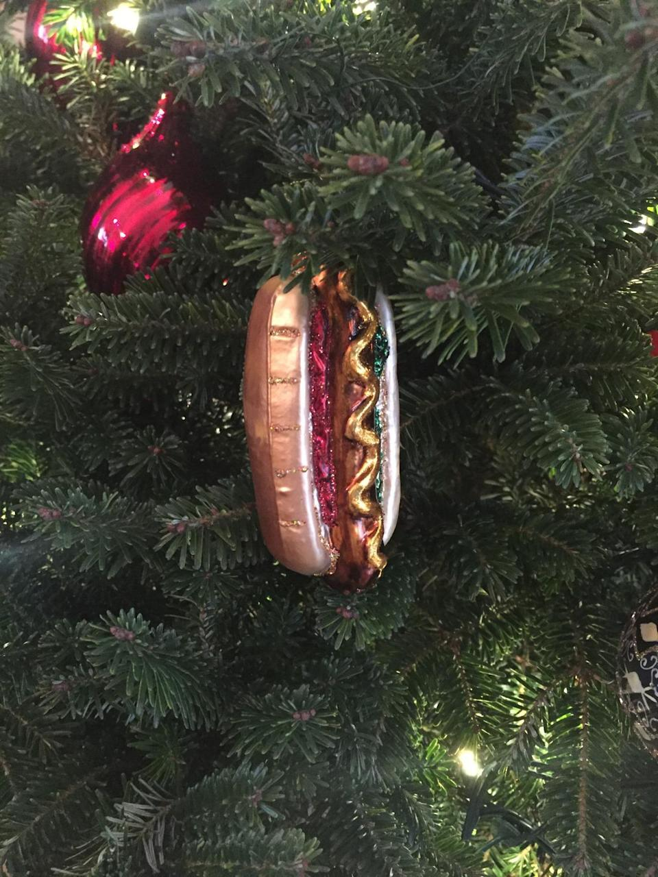 <p>A tree decorated with a theme of dogs features a hot dog ornament. <i>(Photo: Cassie Carothers)</i></p>