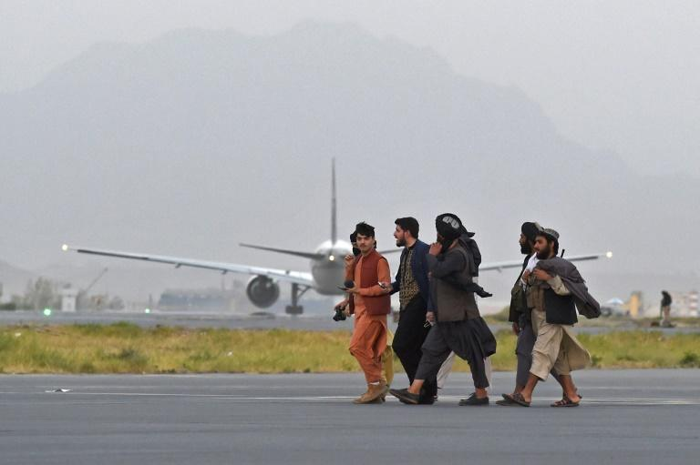Many Afghans in the capital are fearful of a repeat of the hardline Islamist group's brutal and repressive rule from 1996-2001 (AFP/WAKIL KOHSAR)