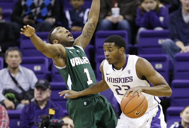 Mississippi Valley State guard DeAngelo Priar (1) begins to tumble backwards on contact with Washington guard C.J. Wilcox in the first half of an NCAA men's basketball game,m Friday, Dec. 27, 2013, in Seattle. (AP Photo/Elaine Thompson)