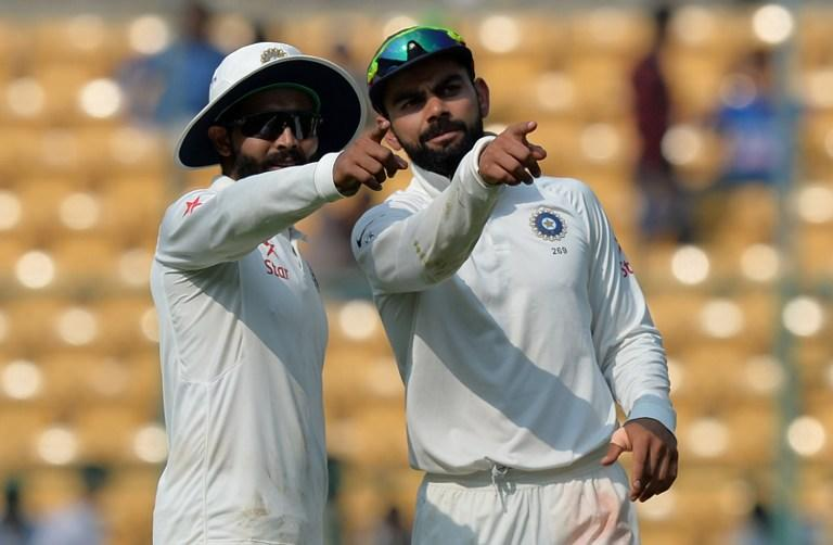 <p>Indian cricket captain Virat Kohli (R) and Ravindra Jadeja share a conversation during the second day of the second cricket Test match between India and Australia at The M. Chinnaswamy Stadium in Bangalore. </p>