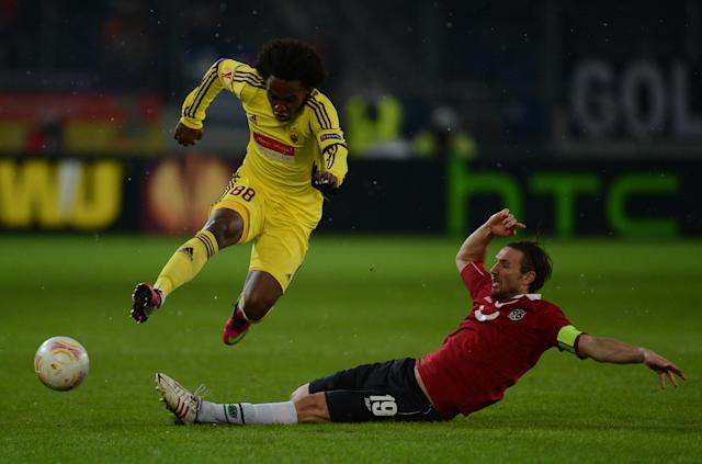 Anzhi Makhachkala's Brazilian midfielder Willian (L) vies for the ball with Hanover's defender Christian Schulz during the UEFA Europa League Round of 32 football match Hannover 96 vs FC Anzhi Makhachkala in Hanover, northern Germany on February 21, 2013. AFP PHOTO / PATRIK STOLLARZPATRIK STOLLARZ/AFP/Getty Images