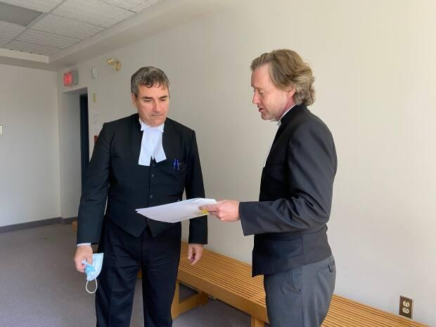 Crown prosecutors Constantin Draghici-Vasilescu and Mark Donohue are shown during a break in the Nova Scotia Supreme Court trial that is taking place in Sydney. (Erin Pottie/CBC - image credit)