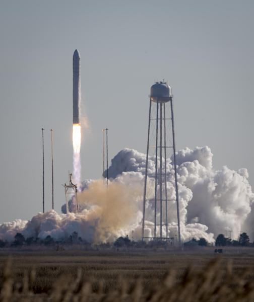 This photo provided by NASA shows an Orbital Sciences Corporation Antares rocket launches at NASA's Wallops Flight Facility, Thursday, Jan. 9, 2014, Wallops Island, Va. Antares is carrying the Cygnus spacecraft on a cargo resupply mission to the International Space Station. (AP Photo/NASA, Bill Ingalls)