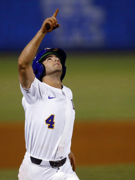 LSU's Josh Smith points as he rounds the bases after hitting a home run against South Carolina during the first inning of the Southeastern Conference tournament NCAA college baseball game Tuesday, May 21, 2019, in Birmingham, Ala. (AP Photo/Butch Dill)