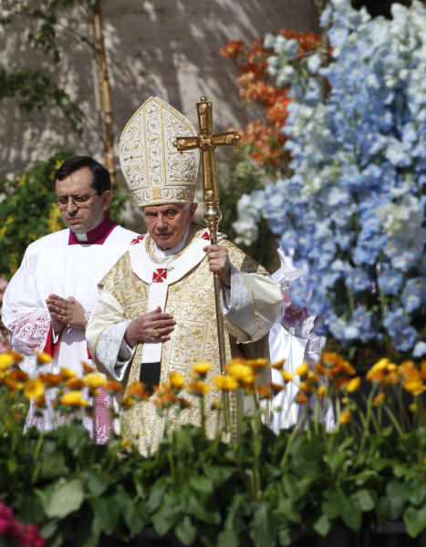Pope Benedict XVI, arrive at the altar to celebrate the Easter Mass in St. Peter's Square at the the Vatican, Sunday, April 8, 2012. Pope Benedict XVI is celebrating Easter Sunday Mass in sun-drenched, flower-adorned St. Peter's Square, before tens of thousands of people. Easter is Christianity's most joyous day. Faithful celebrate their belief that Christ rose from the dead. At the end of Easter Mass, Benedict will go to the central balcony of the basilica to deliver a speech. Benedict, who turns 85 on April 16, was wrapping up stamina-taxing Holy Week ceremonies that drew huge crowds to Rome. (AP Photo/Pier Paolo Cito)